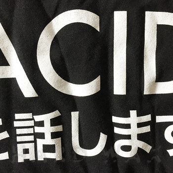 Cover art - T-Shirt, Black, Size M: Je Parle Acid, Japan ed.